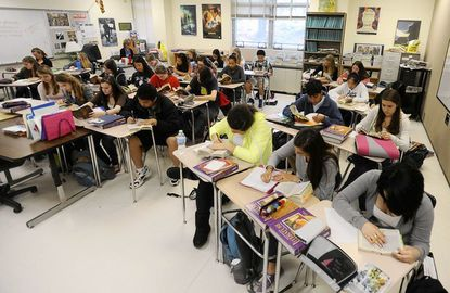 There are 31 students in this gifted and talented English 10 class at Dulaney High School. Classes are becoming larger because of cuts in the numbers of teaching positions.