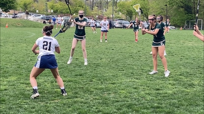 Beth Tfiloh's Sara Silverman (21) passes to her left in an IAAM C Conference girls lacrosse game against Indian Creek.