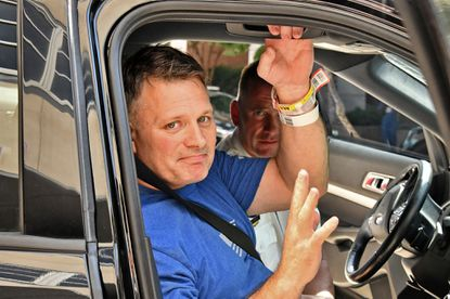 Northern District Sergeant Billy Shiflett waves as gets into the passenger seat after being released from R Adams Cowley Shock Trauma Center at the University of Maryland Medical Center today. Sgt. Shiflett who was wounded in a fatal shooting at a methadone clinic on Maryland Avenue a week ago.