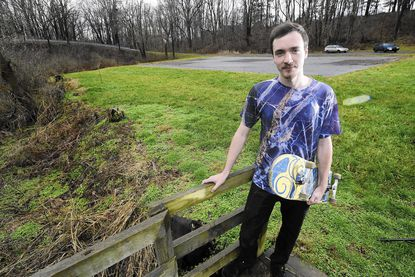 Curtis Blank is pictured next to the empty lot that was the old Manchester skate park.