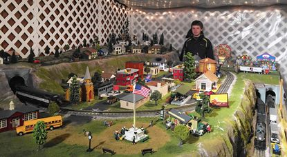 Zan Wills, 15, designed a train garden now on display at Hickory Hill Farm in Street.