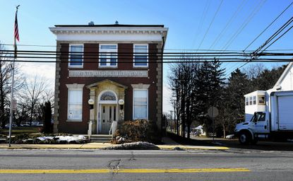 Jos A. Bank Clothiers, based in Hampstead, Md., is facing a hostile takeover bid by its rival Men's Wearhouse. Pictured is the Hampstead Police station on Main Street.