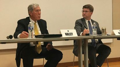 "Albert ""Al"" Nalley and Councilman Tom Quirk speak during the Baltimore County District 1 candidate forum in Catonsville."