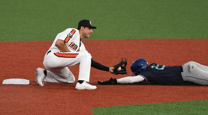 Aberdeen infielder AJ Graffanino tries to put a tag on Asheville runner Zach Daniels, who was called safe in his base-stealing attempt during the sixth inning of Saturday's IronBirds game at Ripken Stadium.