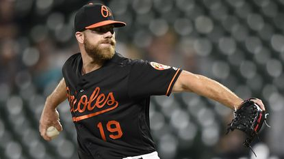 Baltimore Orioles' Chris Davis delivers a pitch against the Minnesota Twins, in the ninth inning of the second game of a baseball doubleheader, Saturday, April 20, 2019, in Baltimore. (AP Photo/Gail Burton)