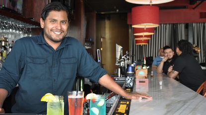 Manager Tommy Carr displays a variety of cocktails offered at Backfins Grille, which held its grand opening June 2.