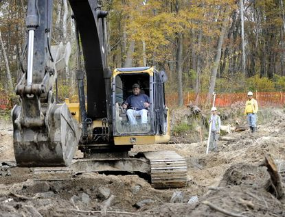 Heavy equipment is used to rebuild a badly eroding stretch of White Marsh Run in Baltimore County.