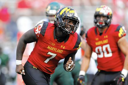 Maryland defensive lineman Yannick Ngakoue (7) smiles after sacking South Florida quarterback Quinton Flowers in the second half of an NCAA college football game, Saturday, Sept. 19, 2015, in College Park, Md. (AP Photo/Patrick Semansky)