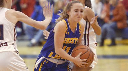 Liberty's Kassie O'Hern drives through traffic in the second half of the Lions' win over Gerstell Academy in Finksburg Friday, Dec. 7, 2018.