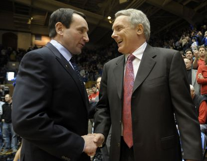 Duke head coach Mike Krzyzewski, left, greets Maryland coach Gary Williams before a game in February 2010.