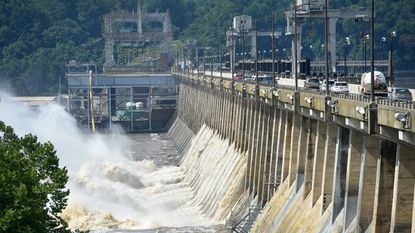 After the recent record rainfall for July, the waters of the Susquehanna River rush through the 17 open spill gates at the Conowingo Dam Thursday morning, July 28. Total gates opened went to 20 later that day, after which the river flow through the dam began to subside.