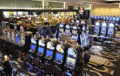Slot machines at the Horseshoe Casino Baltimore. The casino is asked state regulators if it can eliminate 300 of the machines and add 30 more table games.