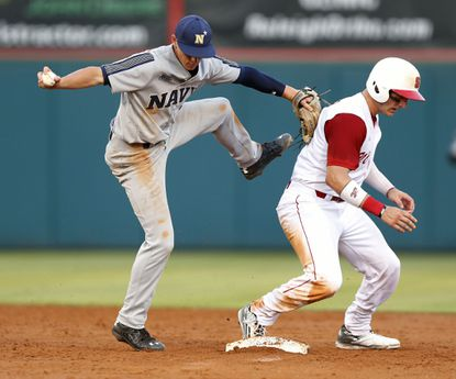 From Friday's game, North Carolina State's Andrew Knizner is out at second but Navy's Travis Blue can't make the throw to first.