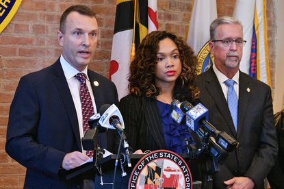 A judge allowed 25 correctional officers indicted in a case brought by Baltimore State's Attorney Marilyn Mosby, above, to be freed pending their criminal trial.