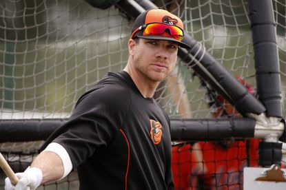 Orioles slugger Chris Davis waits his turn in the batting cage during a spring training workout in Sarasota, Fla..