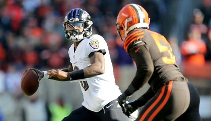 Baltimore Ravens quarterback Lamar Jackson looks to throw with Cleveland Browns middle linebacker Joe Schobert pressuring during the first quarter at FirstEnergy Stadium on Dec. 22.