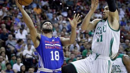 Philadelphia 76ers' Melo Trimble shoots around Boston Celtics' Jayson Tatum during the first half of an NBA summer league basketball game, Tuesday, July 11, 2017, in Las Vegas.