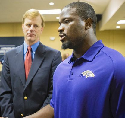 Andrew Tucker, medical director of MedStar Union Memorial Sports Medicine (left) speaks with Ravens linebacker Jameel McClain about their concussion initiative.