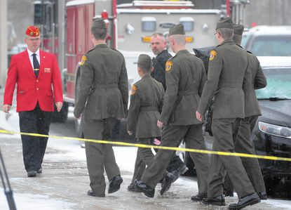 A group from the Harford County Young Marines make their way into the Mountain Christian Church in Joppa Monday to pay their respects to Harford County Sheriff's Office Senior Deputy Patrick Dailey, a Marine Corps veteran who also worked with the Young Marines.