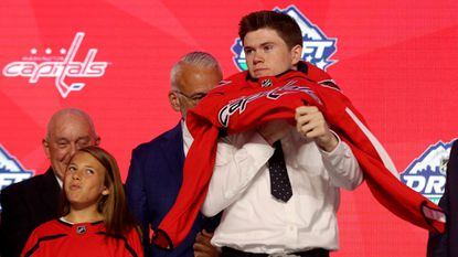 Connor Mcmichael reacts after being selected twenty-fifth overall by the Washington Capitals during the first round of the 2019 NHL Draft at Rogers Arena on June 21, 2019 in Vancouver, Canada.