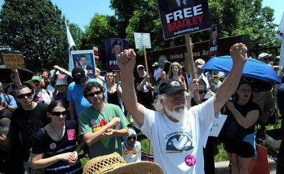 Supporters of Bradley Manning hold a rally at the gates of Fort Meade ahead of his trial.