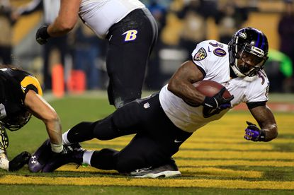 Bernard Pierce scores in the second quarter of the Ravens' wild-card win over the Pittsburgh Steelers.
