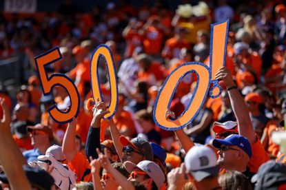 Denver Broncos fans hold up signs to celebrate the 500th career touchdown pass by quarterback Peyton Manning.