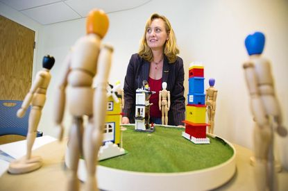 Amy Shelton, a cognitive psychologist, shows the windmill display at her Johns Hopkins University office.
