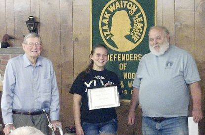 The Izaak Walton Sportsman Chapter awarded the second annual James A. Thomas Conservation Scholarship to Kourtney Rutkowski, center, a graduate of C. Milton Wright High School, at its June membership meeting. Rutkowski will be attending University of Maryland, Baltimore County and plans to study environmental science. Rutkowski is standing with James A. Thomas, left, and Doug Howard, IWLA Sportsman Chapter president.