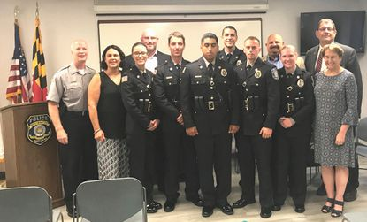Present at the ceremony: Chief Tom Ledwell, Councilmember Gilbert, Mayor Joe Dominick, police officers Courtney Brandt, Nolan Carbaugh, Eduardo Garduno, Brian Smith, Brandon O'Neil, and Mindy Phillips, councilmembers Chiavacci, Dayhoff, and Admin. Barb Matthews.