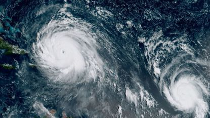 This Sept. 7, 2017 satellite image made available by NOAA shows the eye of Hurricane Irma, left, just north of the island of Hispaniola, with Hurricane Jose, right, in the Atlantic Ocean. (Courtesy/NOAA)