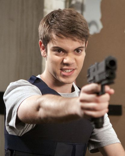 Shane's packing heat in episode five.
