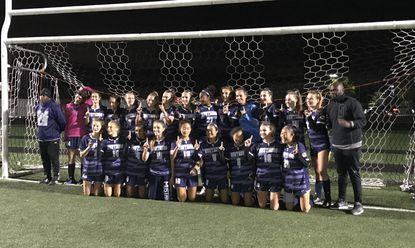 The Marriotts Ridge girls soccer team poses for a picture after beating Centennial, 1-0, on Thursday, Oct. 17, 2019. The Mustangs went 8-1 in Howard County play to win the county championship.