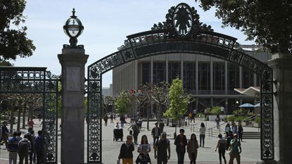 Students walk past Sather Gate on the University of California at Berkeley campus in Berkeley, Calif. last May.