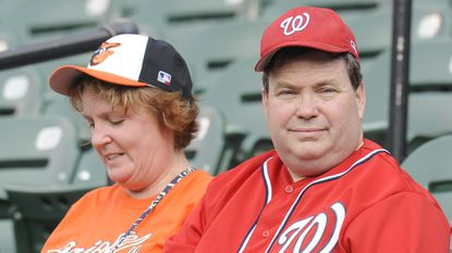 Fans relax before start of a baseball game between the Washington Nationals and the Baltimore Orioles.