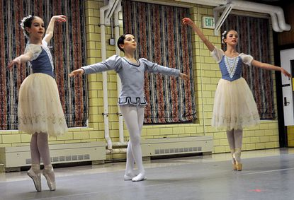 """Rebecca Pasquino, left, Jacob Black, center, and Cambria Stetson, right, perform as the Trio Mirlitons in a performance of """"The Nutcracker"""" on the Springfield Hospital Center grounds Monday, Nov. 26."""