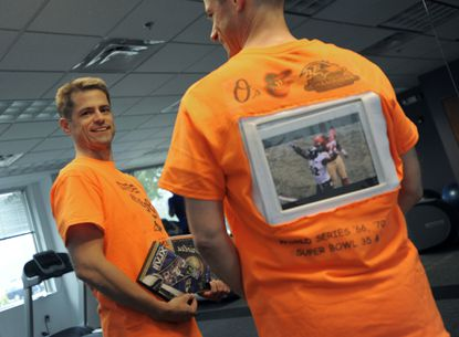 Mike Woodring with his shirt that has an iPad built in to the back. Woodring will be running in the Baltimore marathon and will be playing highlights of the Orioles' and Ravens' championships.