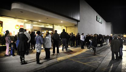 Customers line up outside the Sears store at Security Square mall on Thanksgiving night in this 2012 photo. The company's new owners announced the store will close in October.