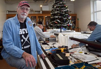 Dave Balthis, left, a retired Howard County firefighter, has engineered the Ellicott City Volunteer Fire Department's annual train garden for the past 22 years. He and many volunteers are putting together this year's display.