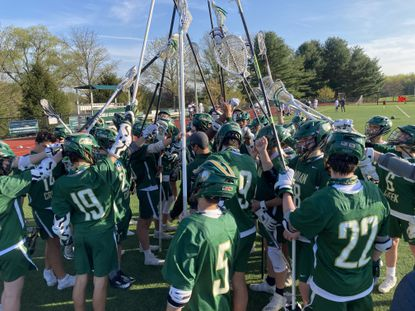 The Indian Creek boys lacrosse team celebrates after beating Glenelg Country, 13-12, in Ellicott City on Tuesday for the program's first MIAA B Conference win.
