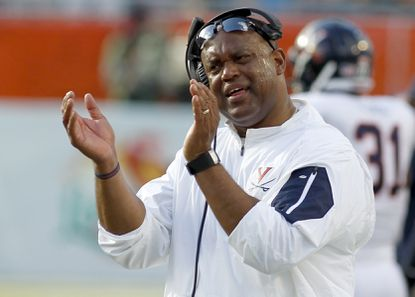 Virginia head coach Mike London reacts on the sidelines in the second quarter of play against Miami in an NCAA college football game, Saturday, Nov. 7, 2015, in Miami Gardens, Fla.