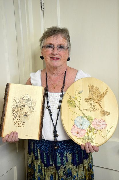 Nancy Horn, of Westminster, shows off a couple of her works.