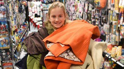 "Enya Sliwinski, 10, collects coats for ""One Warm Coat"""