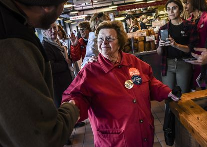 Sen. Barbara Mikulski, center, greets voters inside the Belvedere Square market in Baltimore, Maryland as she campaigns for Rep. Chris Van Hollen, D-Md., and other Maryland Democrats on November, 5, 2016.