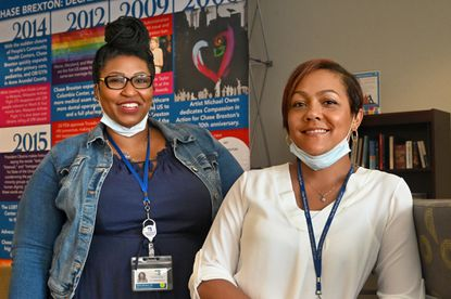 Ebony Beckles, left, and Heidi Whiting, Medication Support Team adherence nurses at Chase Brexton Health Care, continue to connect and care for their HIV patients despite the challenges presented by COVID-19. June 11, 2020