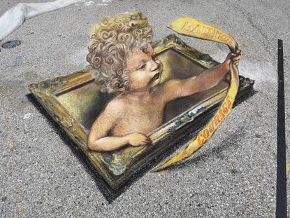 "International artists made chalk drawings on the streets of Little Italy for the Madonnari Arts Festival in September. This year's theme was ""courage."" - Original Credit: Baltimore Sun"