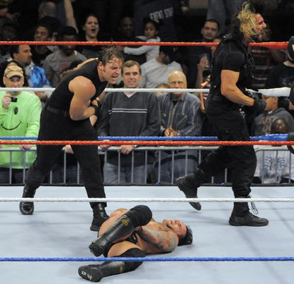 Dean Ambrose has a few words for CM Punk after Punk's loss to Roman ReignsduringWWE's Monday Night Raw wrestling at the Baltimore Arena on Jan. 16, 2014.