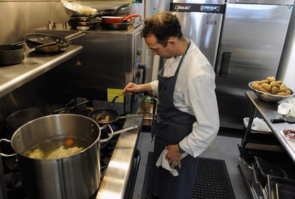 Steve Monnier is opening a new French bistro, Chez Hugo, in downtown Baltimore. He previously owned Aromes in Hampden, where he is pictured in the kitchen.