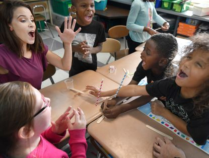 Halls Cross Roads Elementary School teacher Lindsay Muir celebrates with a group of her students in Aberdeen.