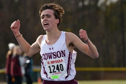 Towson's Peter Sorensen celebrates as he finishes second in the Class 3A boys race during the MPSSAA State Cross Country Championships at Hereford High School on Nov. 9.